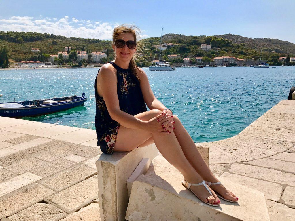 Me sitting by the sea waiting for a ferry on Kolocep Island, Croatia