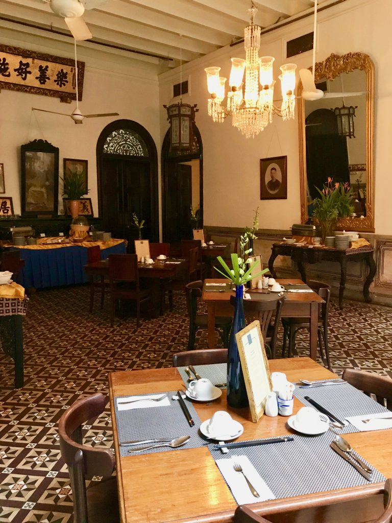 Tables set for breakfast in the dining area at the blue mansion