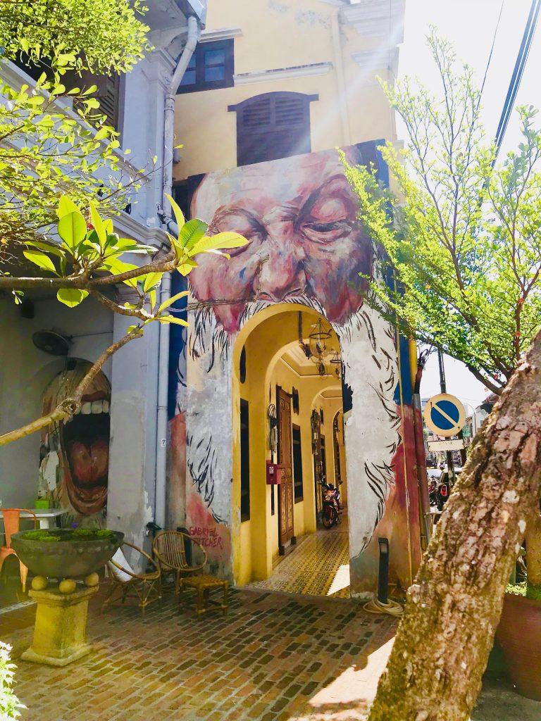 Street art of a bearded man in Penang