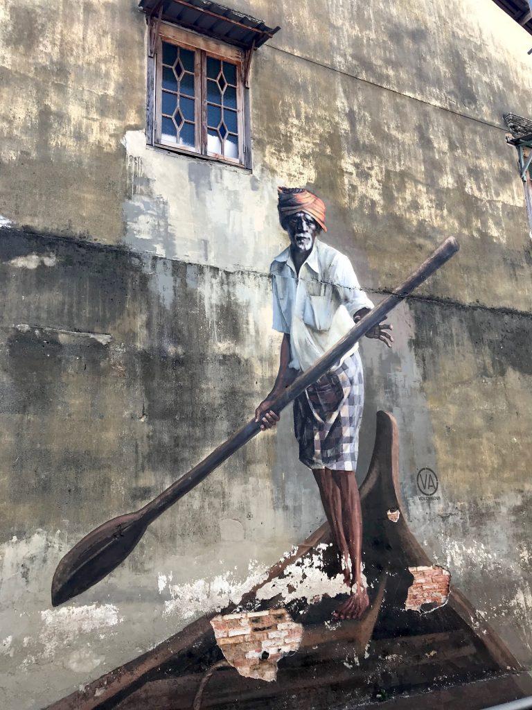 Street art of a boatman in Penang