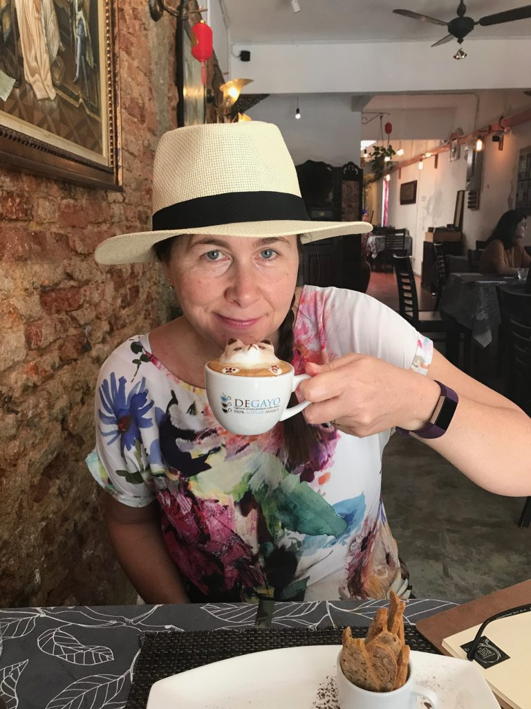 Angie drinking coffee in Penang
