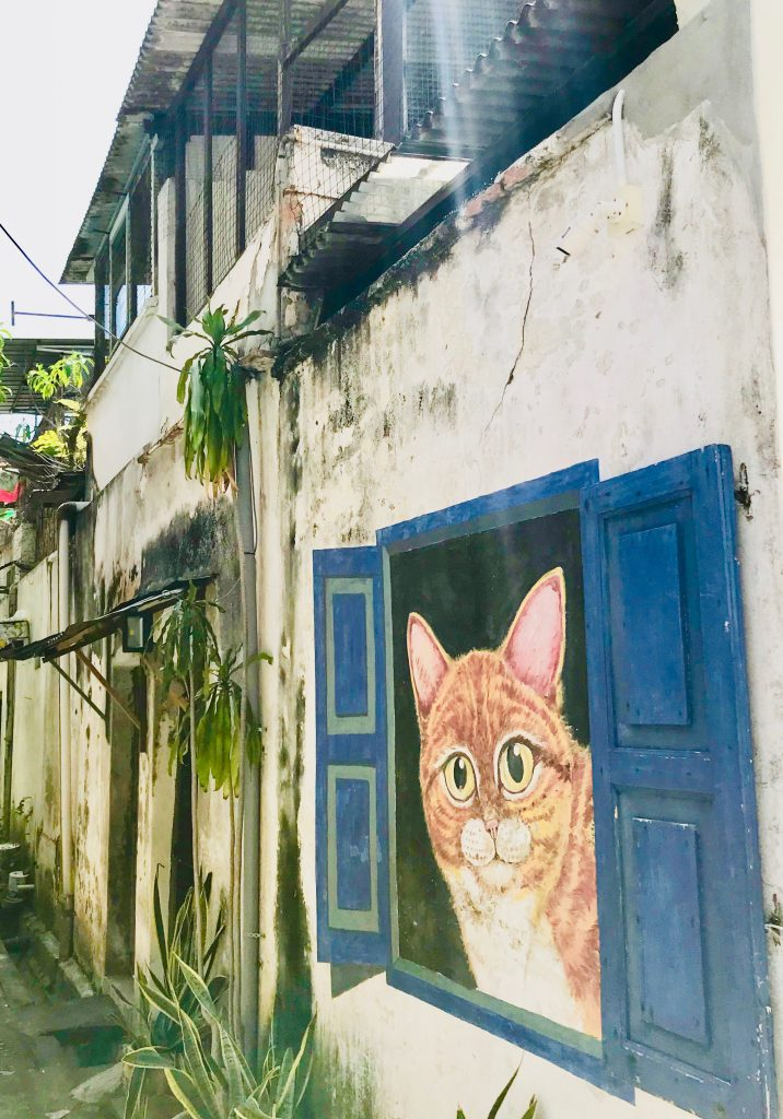 Street art of a cat in George Town