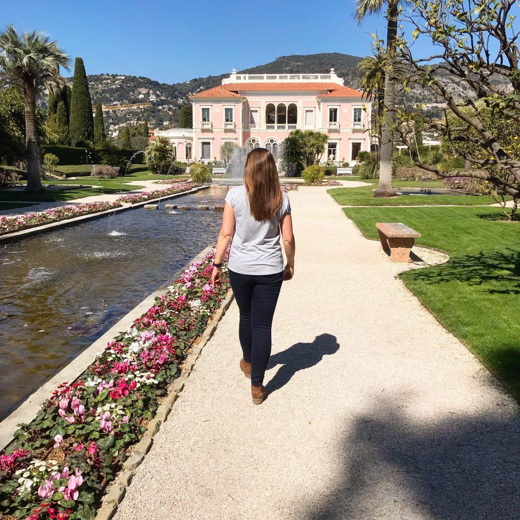 Angie walking through gardens at Villa Ephrussi
