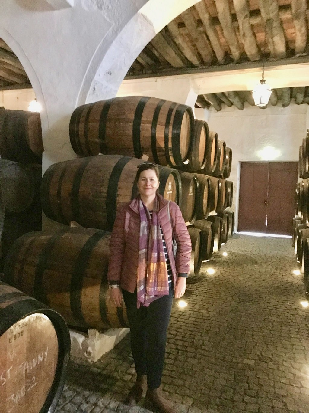 me standing in port cellars during a tour
