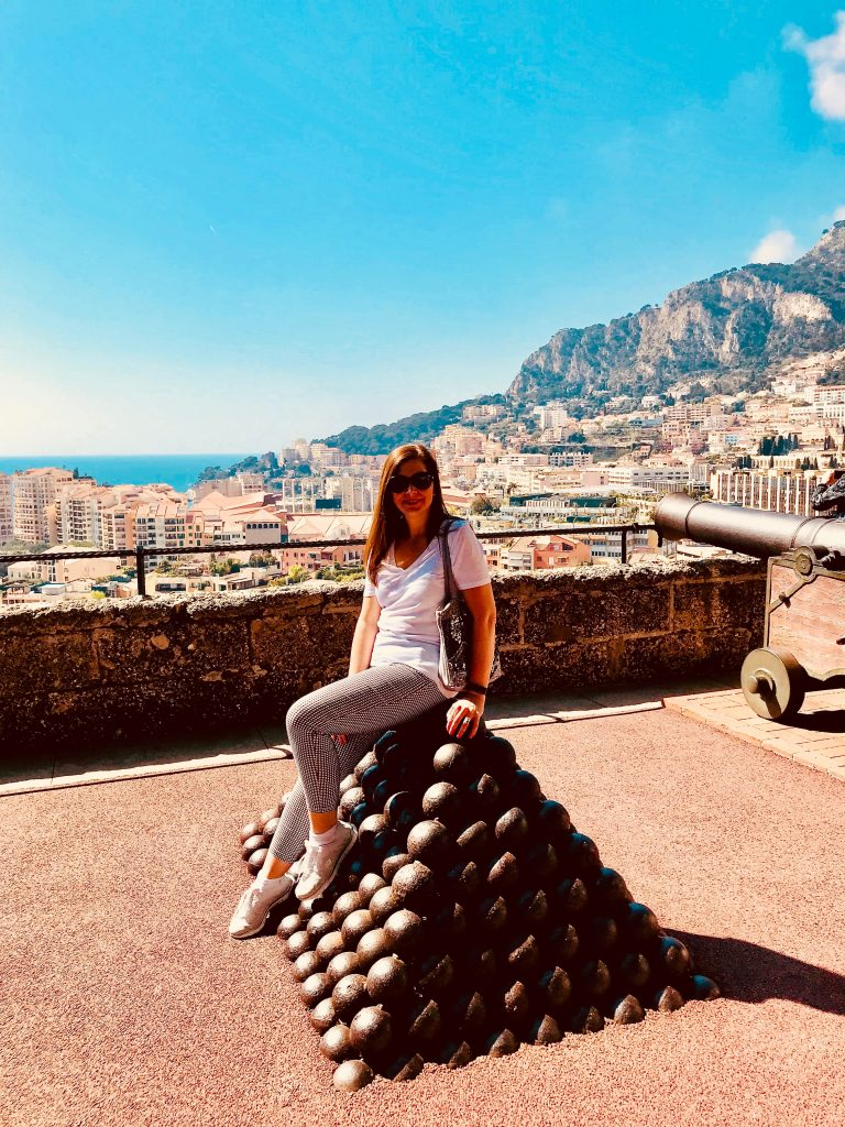 Sitting on cannonballs outside the Palace of Monaco in the French Riviera
