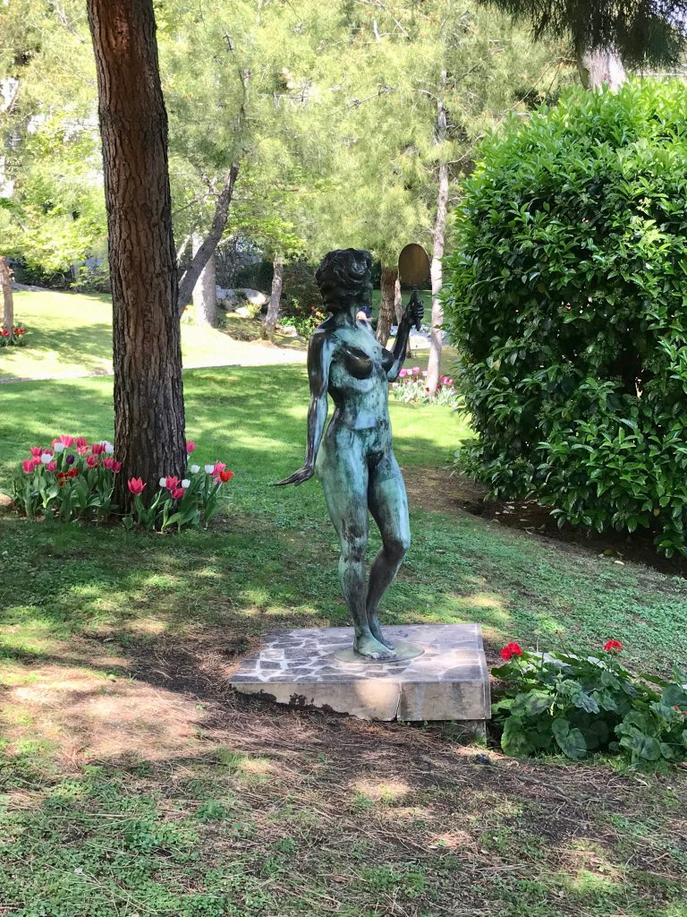 A statue in the gardens of Monaco Cathedral depicting a woman form. The French Riviera