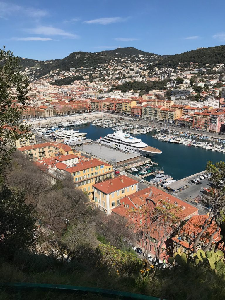 The view from Castle Hill of Nice Marina with a super yacht anchored in the middle of it, The French Riviera