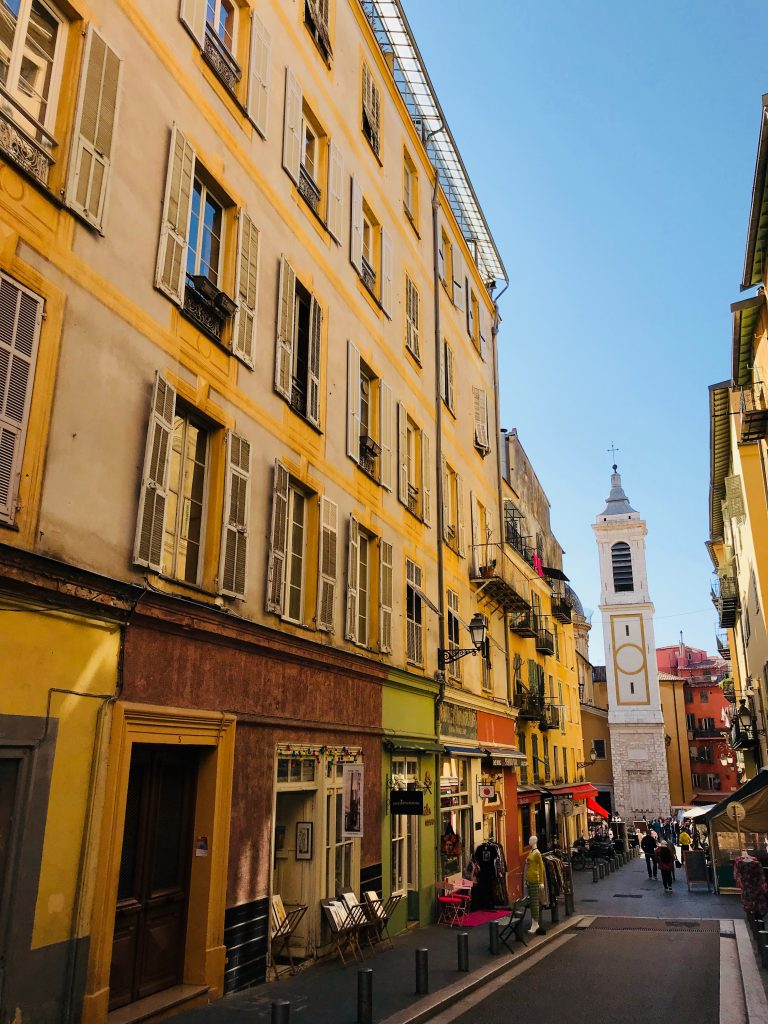 The old town of Nice showing a building painted bright yellow on the French Riviera