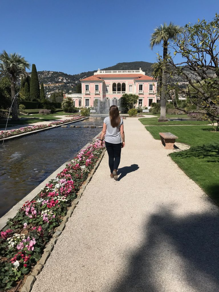 A woman walking along the French Gardens at the Villa Ephrussi