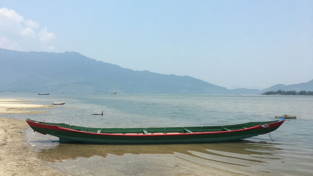 Colourful fishing boat on Lap An Lagoon