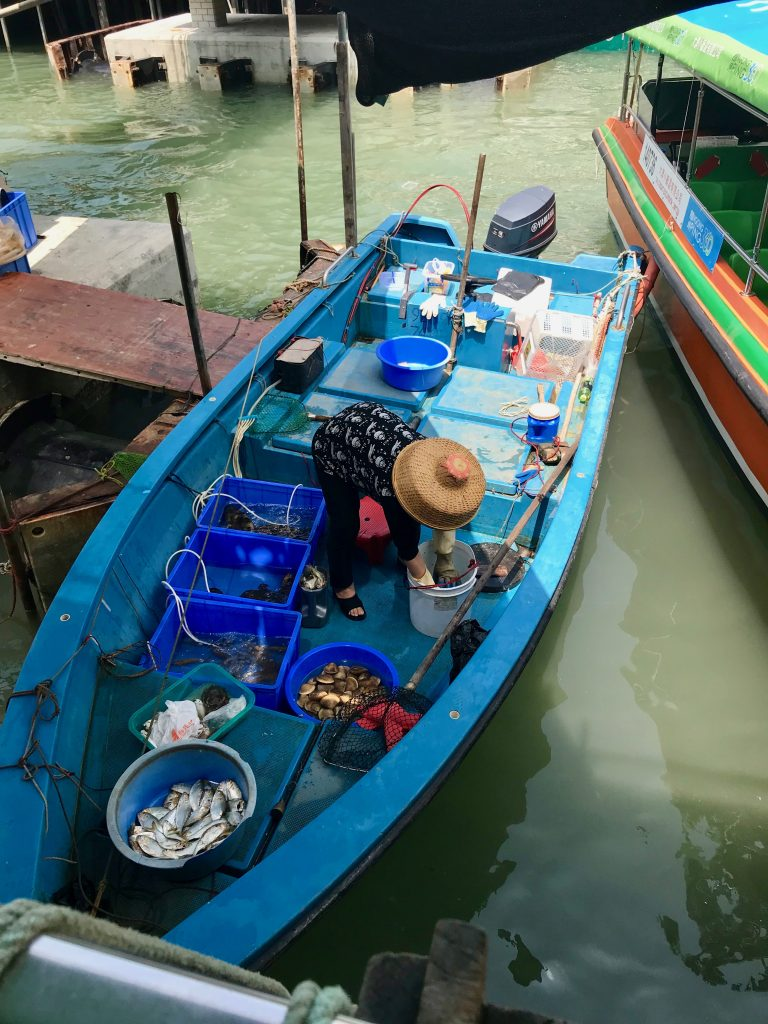 Local fisherman and boat in Tai O village