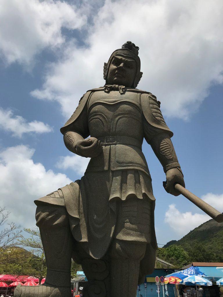A statue representing a Chinese Zodiac Deity