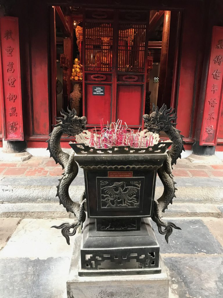 Large urn with burning incense
