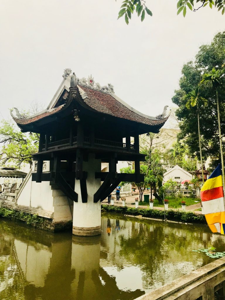 A temple on one pillar above a body of water in Hanoi