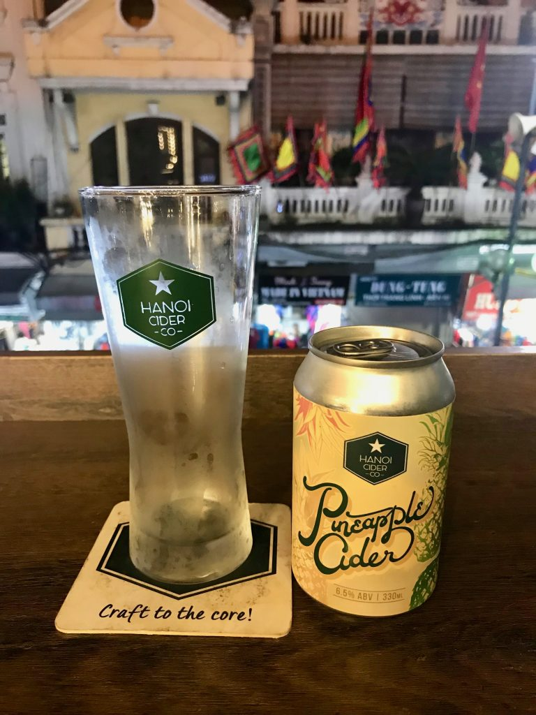 A can of cider and a glass made by a brewery in Hanoi