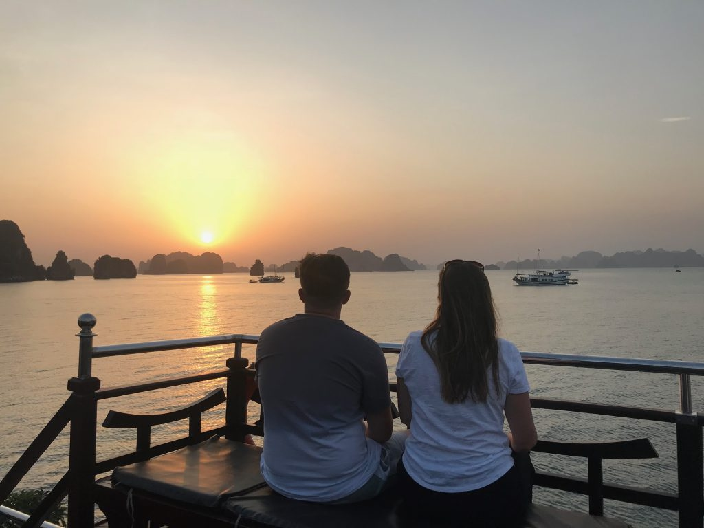 Watching the sunset over Bai Tu Long Bay from the upper deck of the cruise boat