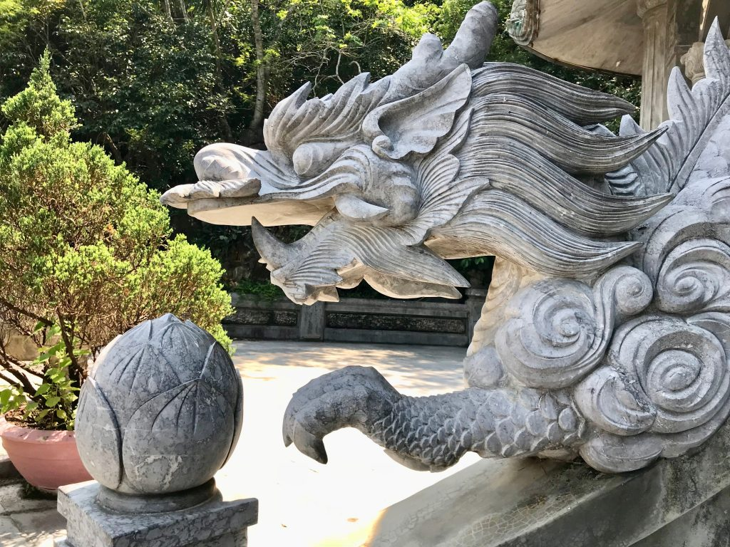 A carved white marble dragon statue