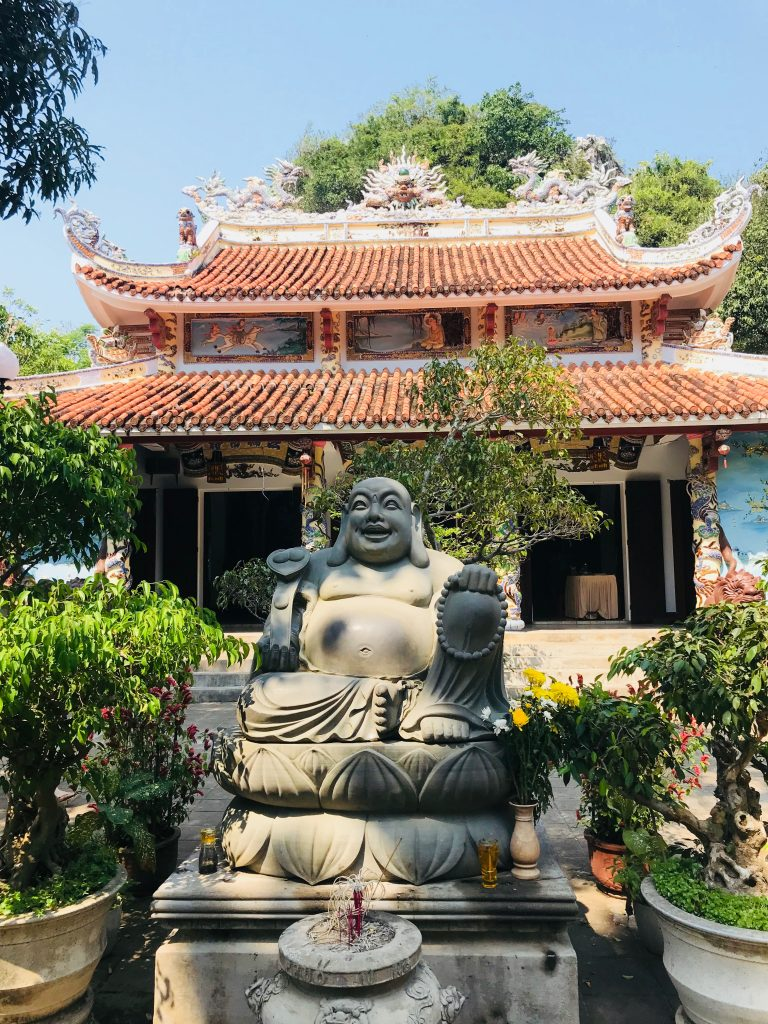 Tam Thai pagoda with statue of a seated buddha