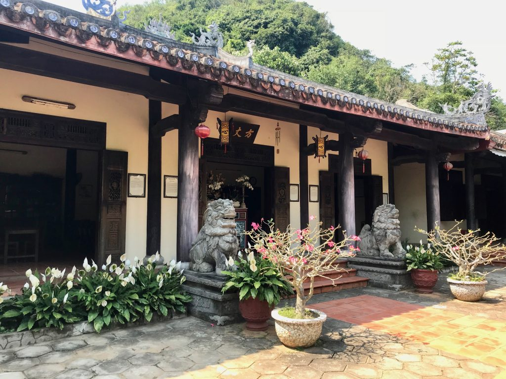 Buddhist place of worship with lion statues at the entrance