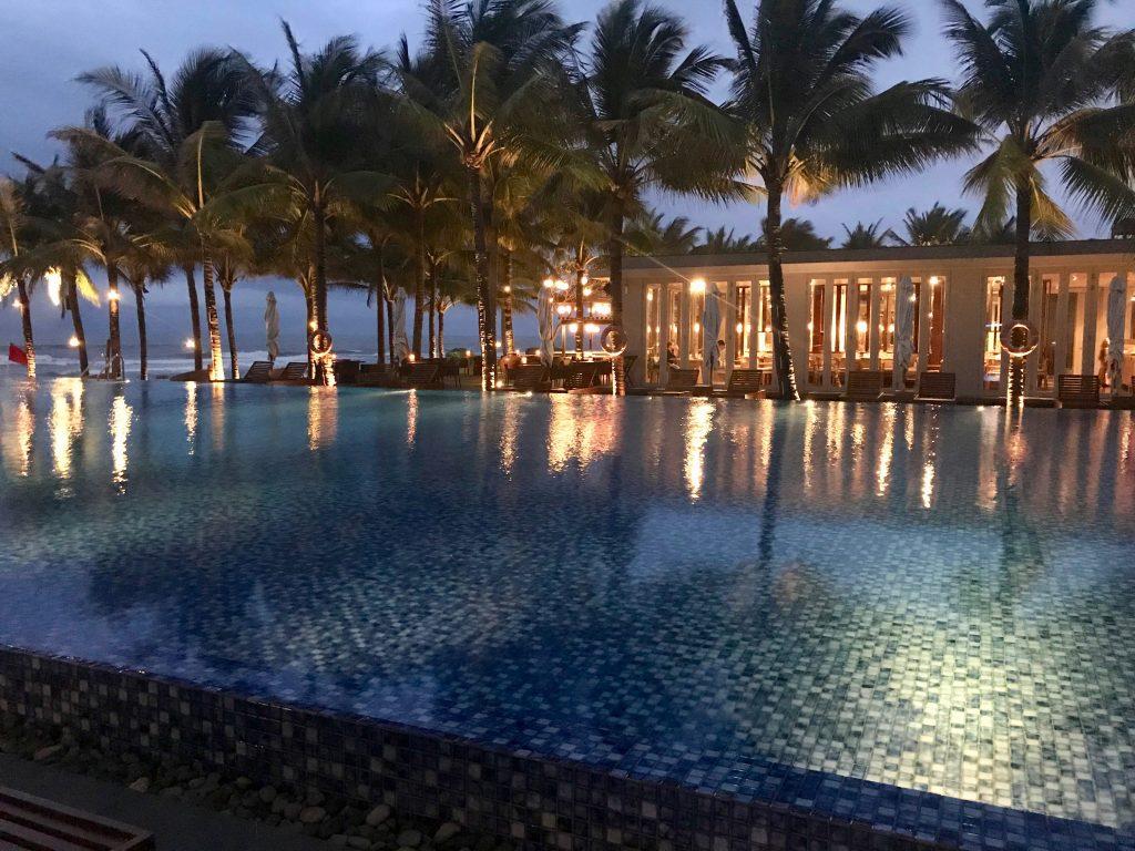 Infinity pool illuminated at night