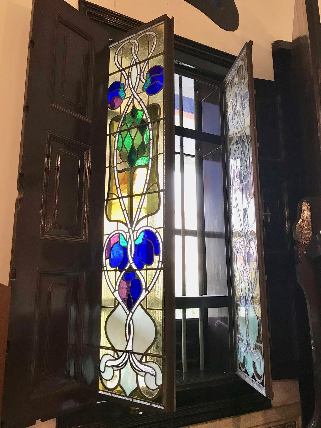 stained glass window in the blue mansion