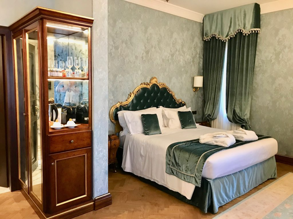 Hotel Nani Mochenigo bedroom showing bed and fabrics