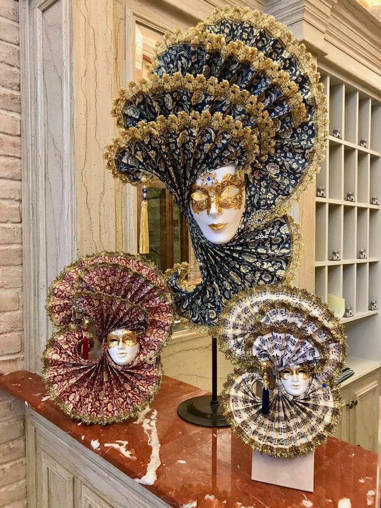 Three Venetian Masks in different colours at reception