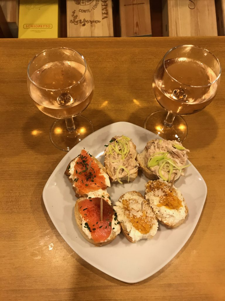 The local dish of cicchetti with wine.