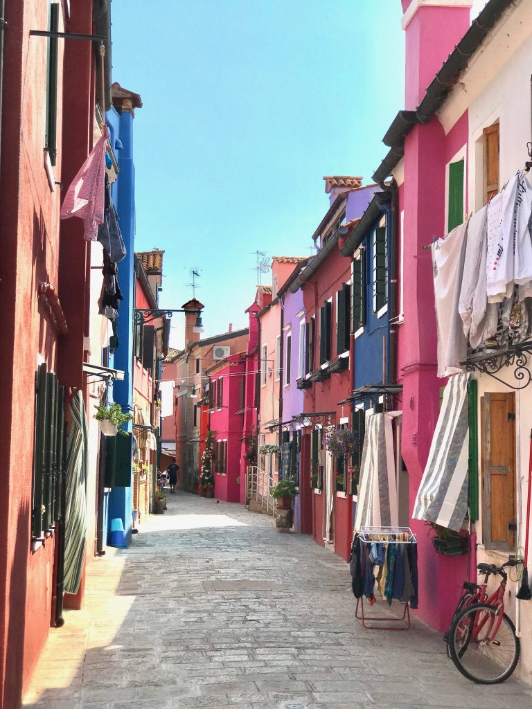 A street in burano showing pastel coloured houses