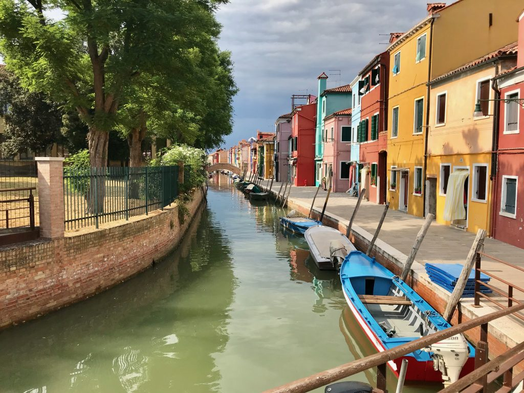 Colourful houses along a canal in Burano, Venice
