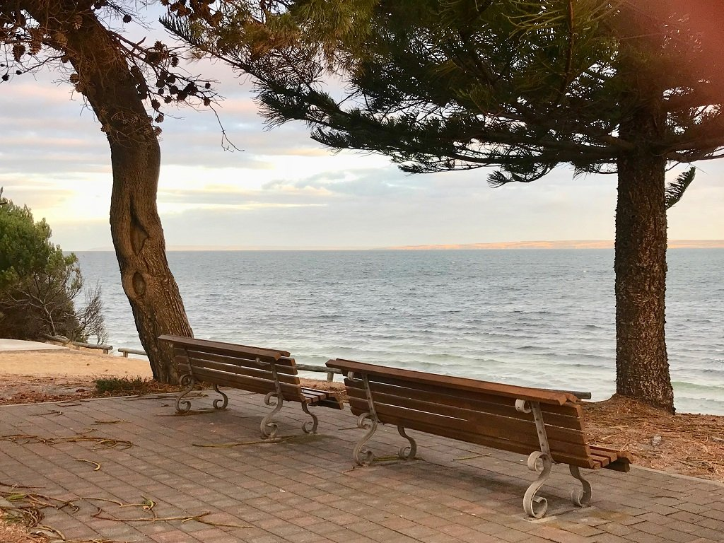 a bench by the sea at Kingscote