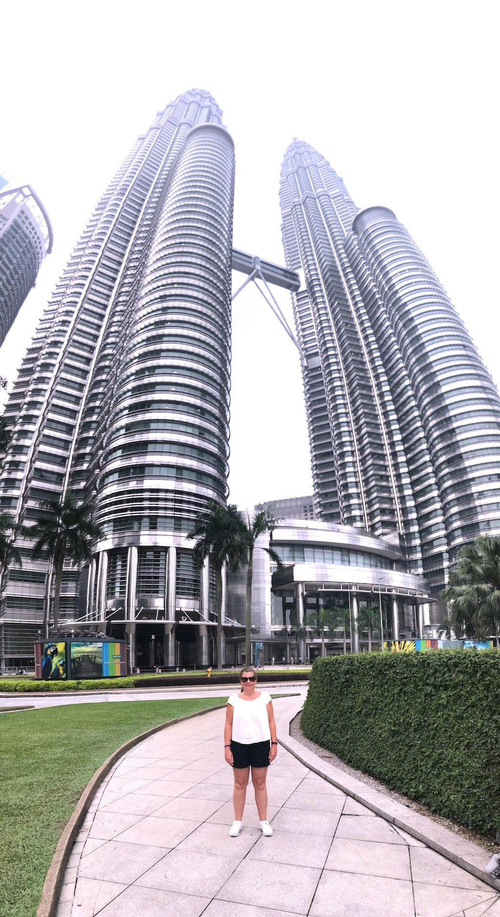 Woman Standing in Front of the Petronas Towers