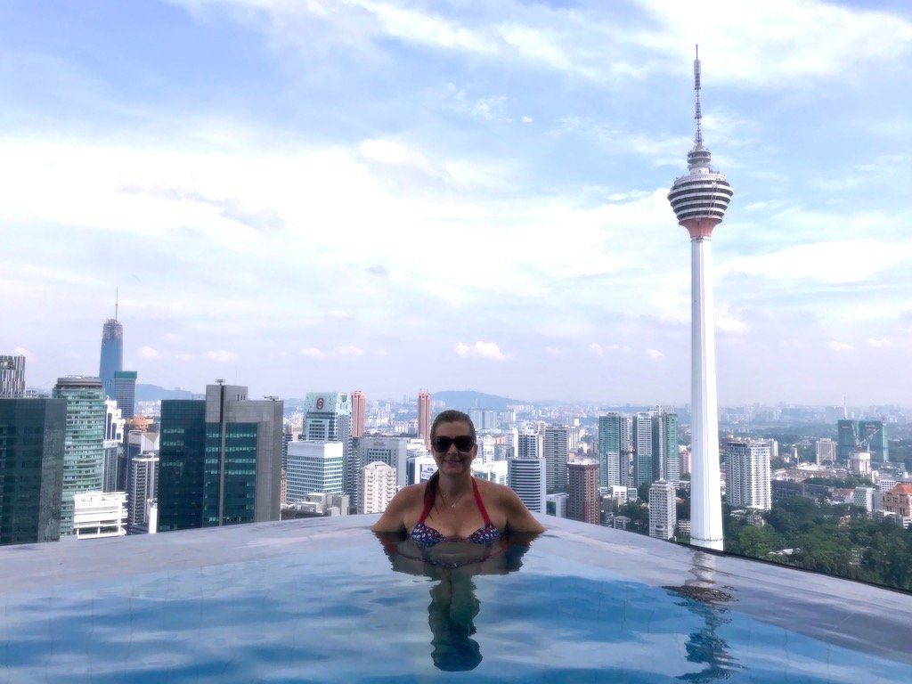 woman in a rooftop pool