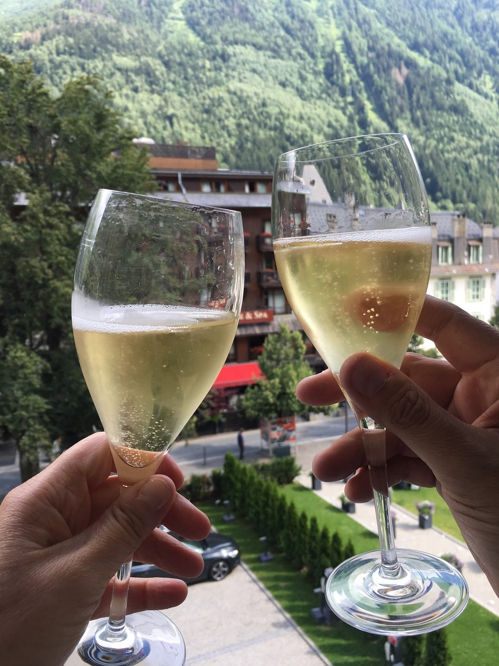 two Champagne glasses with the backdrop of Mont Blanc