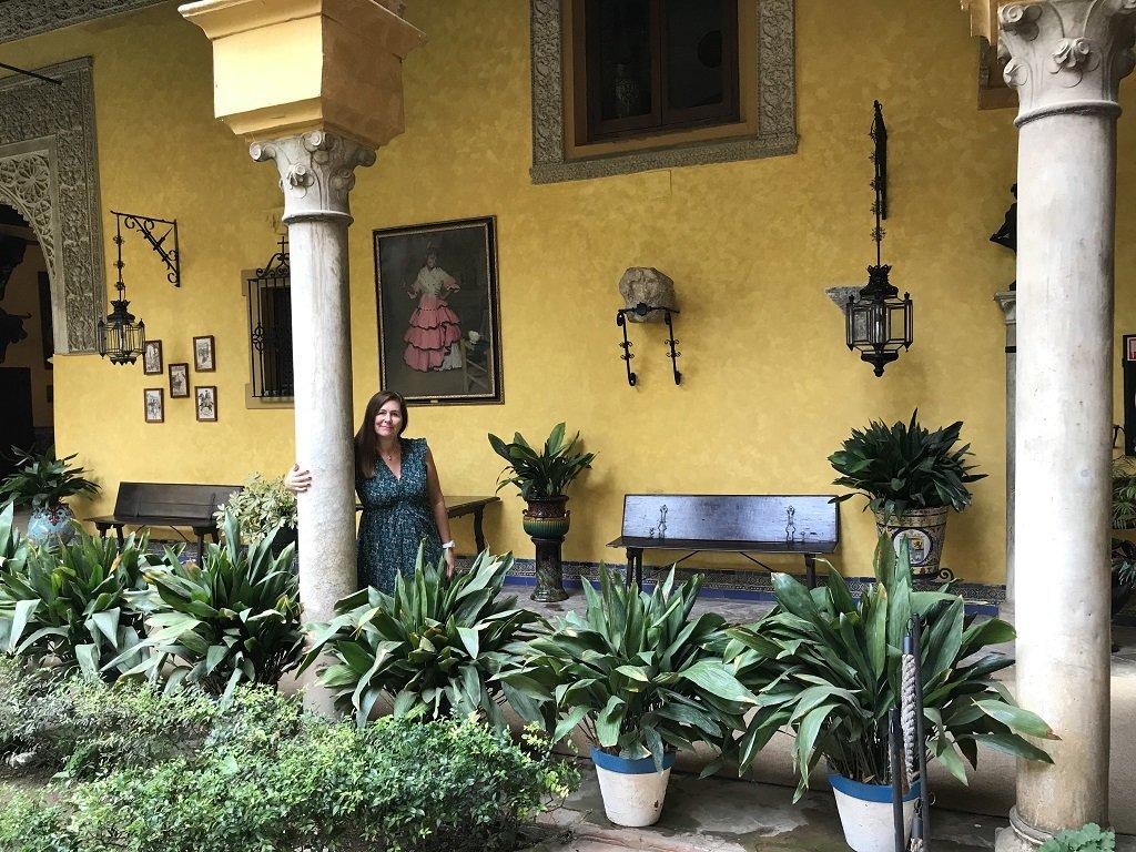 A woman standing in the courtyard at the Palacio de las Duenas
