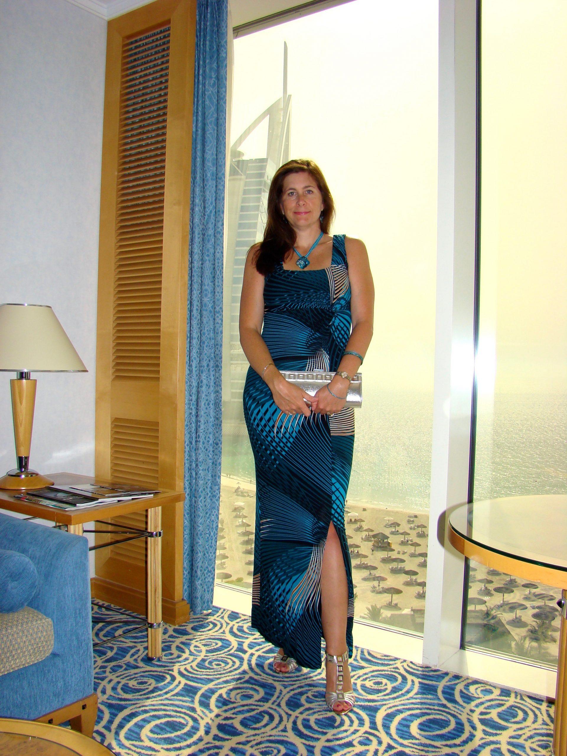 woman wearing a floor-length blue dress in Dubai