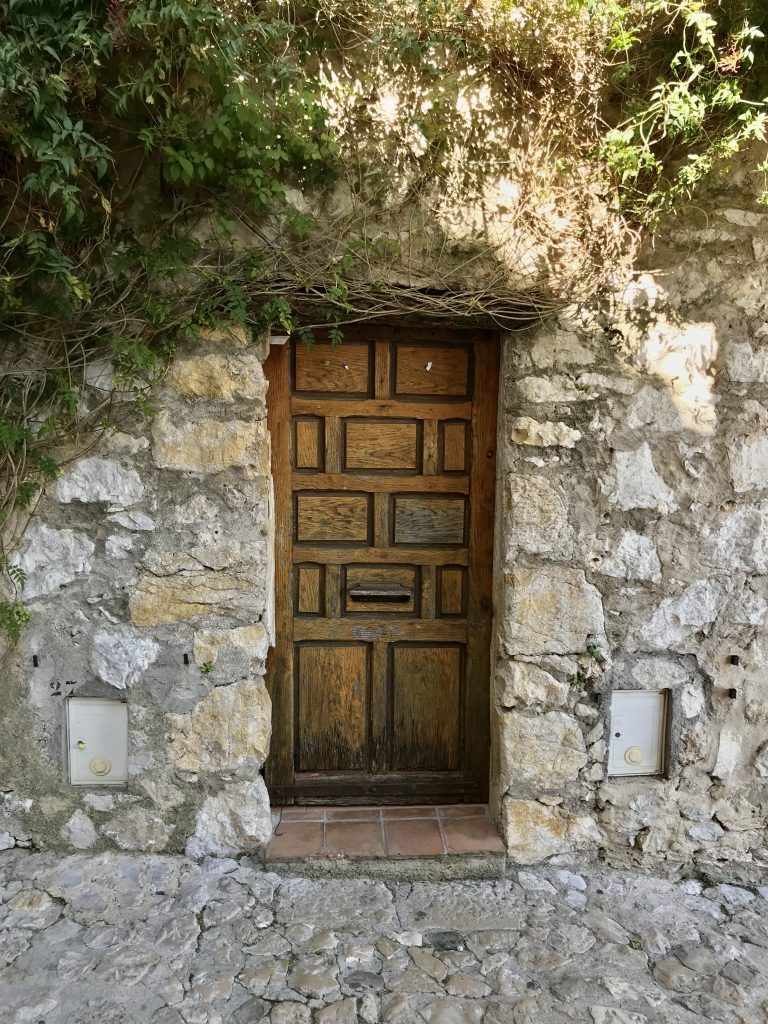A secret door in the stone wall