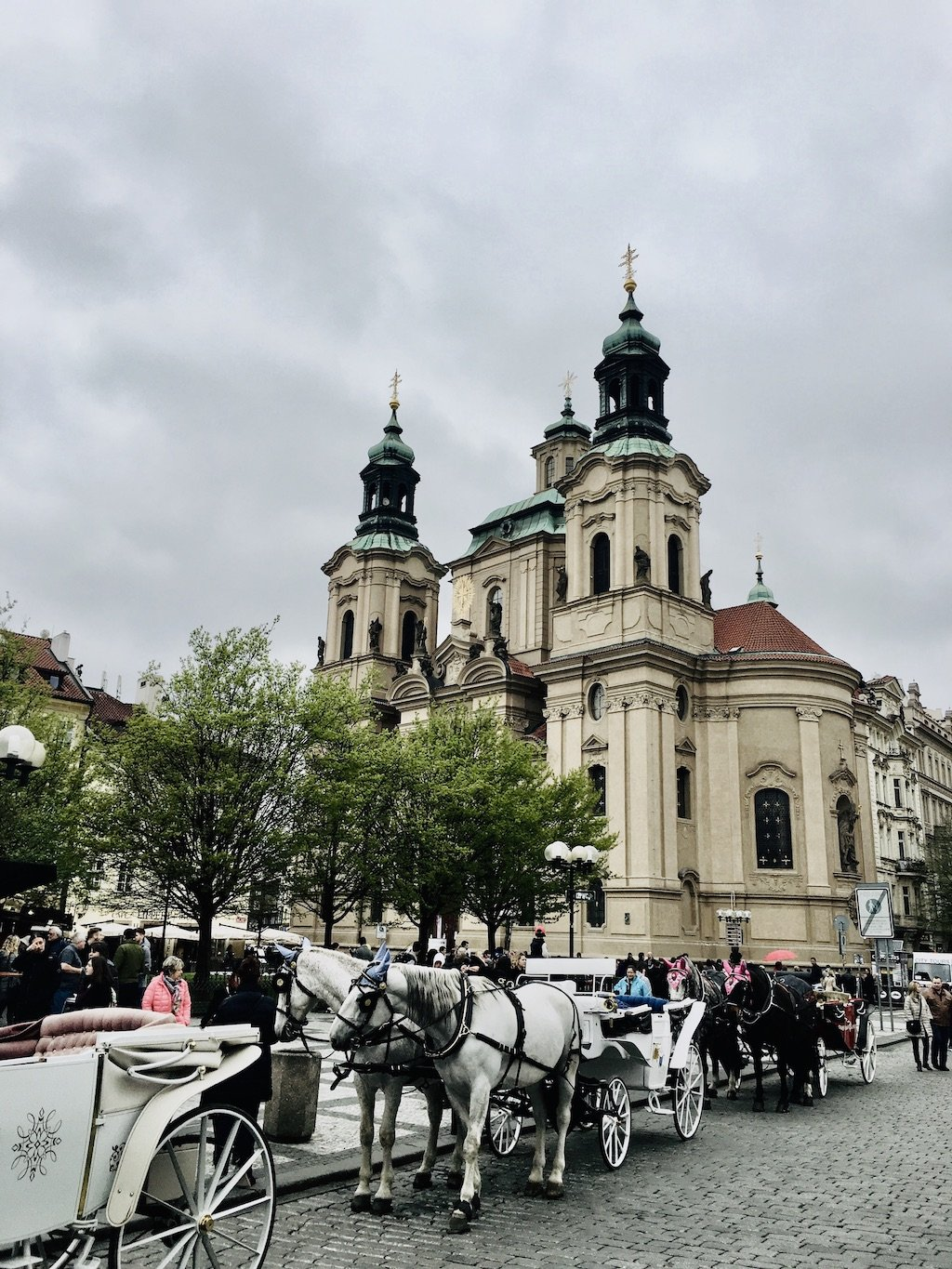 Horse carriage rides outside the lady of our Tyn church