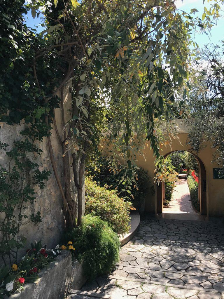 A walkway through the French garden