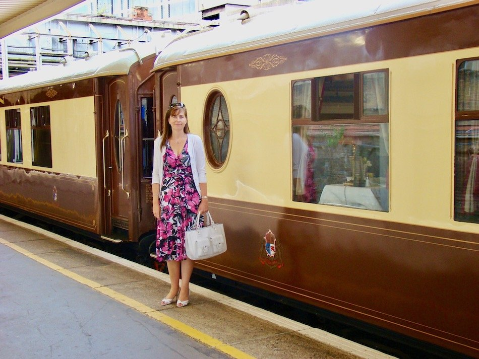 a lady standing by the Belmont train