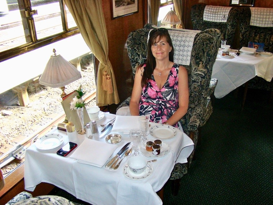 A lady sitting at a table on the Belmond