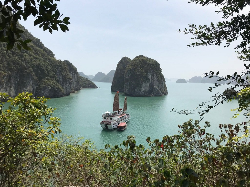 Photo taken from shore of a cruise boat in Halong Bay