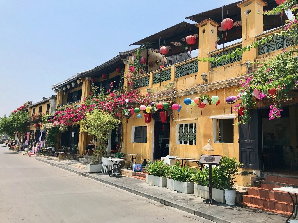Photo of one of Hoi An's yellow buildings covered with lanterns