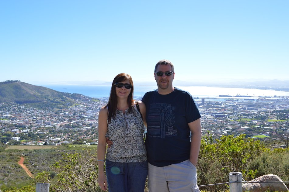 man and woman standing at the top of Table Mountain