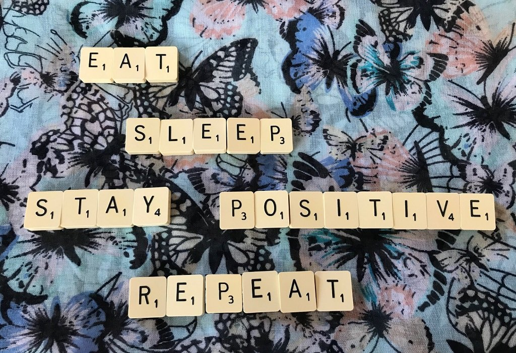 a sentence made from scrabble saying Eat.Sleep.Stay Positive. Repeat