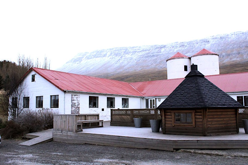 a white building with a red roof in Iceland