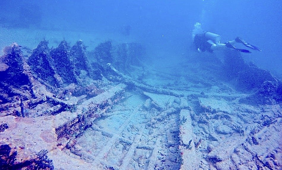 underwater shipwreck ruins with a diver