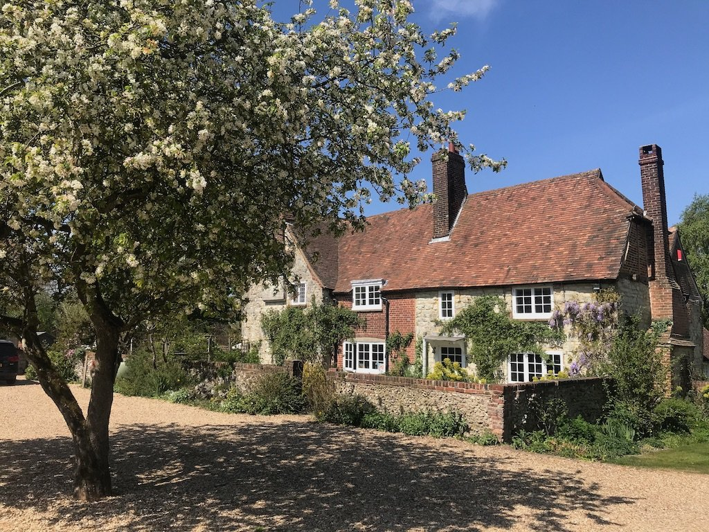 a Manor House located near to a flowering tree