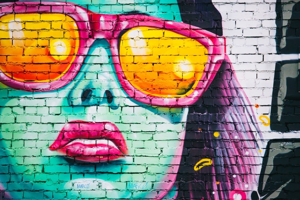 street art of a ladies face in bright colours