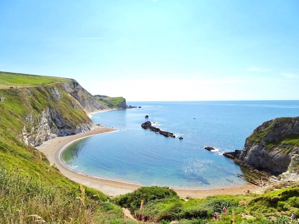 A coastal view of Lulworth Cove in Dorset